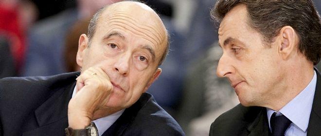 Alain Juppé, nouveau ministres des Affaires étrangères, et Nicolas Sarkozy.