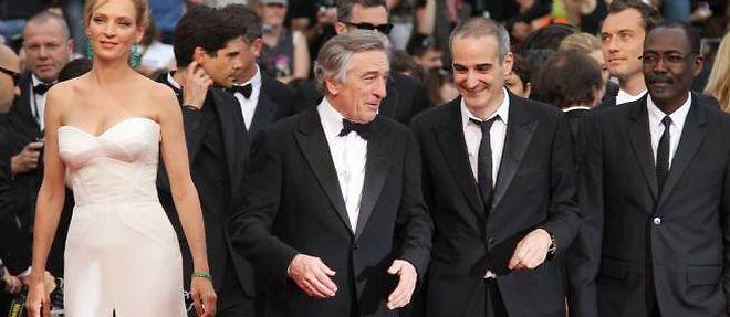 Uma Thurman, Robert de Niro, Olivier Assayas et Mahamat Saleh Aroum, membres du jury 2011, font leur montée des marches à Cannes. ©Valéry Hache