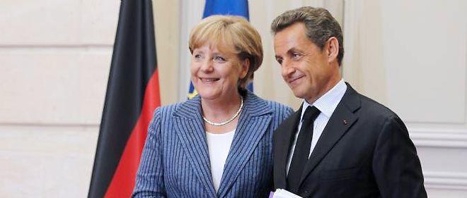 Merkel et Sarkozy s'engagent à harmoniser l'impôt sur les sociétés en France et en Allemagne.