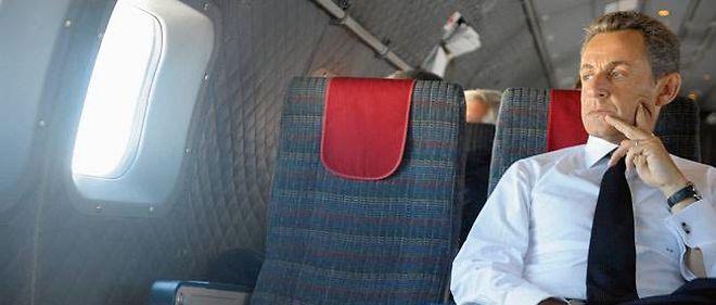 Nicolas Sarkozy dans l'avion lors de sa visite officielle en Nouvelle-Calédonie en octobre 2011, photographié par Elodie Grégoire.