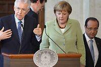 Mario Monti, Angela Merkel et François Hollande lors de la conférence finale du sommet de Rome le 22 juin. ©Alberto Pizzoli