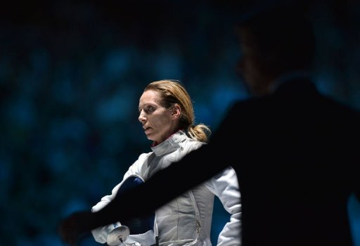 Italy's Valentina Vezzali reacts after being defeated by Italy's Arianna Errigo at the end of their women's foil fencing semifinal bout as part of the London 2012 Olympic games, on July 28, 2012 at the ExCel centre in London. AFP PHOTO / ALBERTO PIZZOLI