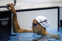 La championne olympique du 400 m nage libre en 2004 à Athènes a fini 8e et dernière de sa série en 1:01.03. ©Leon Neal
