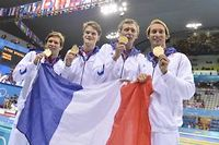 Les Français du relais 4x100 mètres nage libre ont imité Camille Muffat en devenant champion olympique. ©Fabrice Coffrini