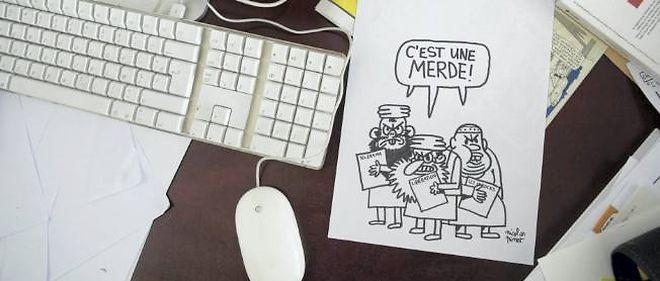 """Dans les locaux de """"Charlie Hebdo"""", mercredi, jour de la sortie d'un numéro contenant des caricatures de Mahomet."""