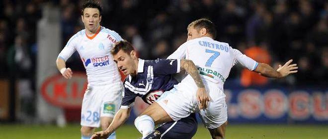 Mathieu Valbuena (arrière-plan) a été remplacé en cours de partie en raison d'une blessure.