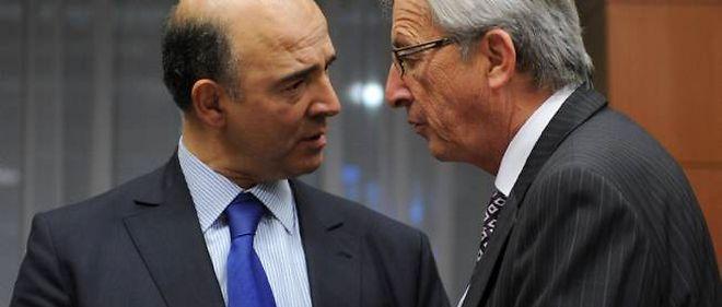 Pierre Moscovici et Jean-Claude Juncker, mardi soir à Bruxelles.