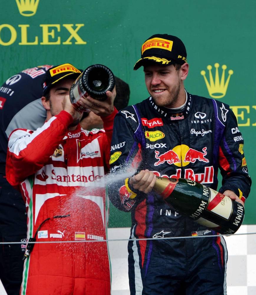La joie de Vettel et Alonso, premier et deuxième au Canada. © STAN HONDA / AFP