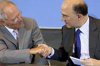 Pierre Moscovici et Wolfgang Schäuble devront s'entendre sur une procédure de mise en faillite des banques qui fasse e moins possible appel à l'argent du contribuable européen. ©DAVID GANNON