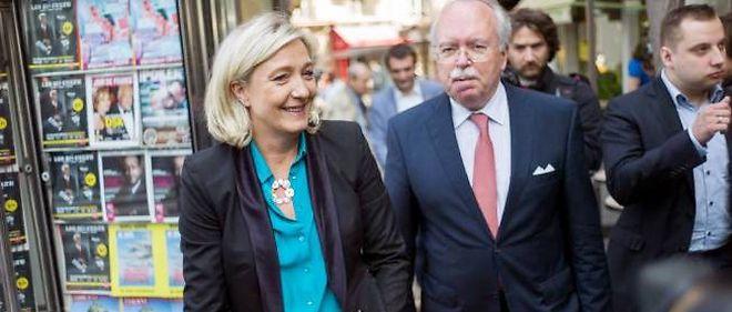Marine Le Pen accompagnée de Wallerand de Saint-Just, le candidat FN à la mairie de Paris.