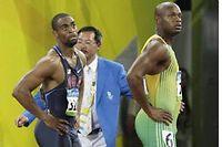Tyson Gay et Asafa Powell lors de la demi-finale du 100 mètres des JO de Pékin, en 2008. ©Thomas Lohnes