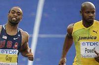 Tyson Gay et Asafa Powell lors de la demi-finale du 100 mètres des Mondiaux de 2009. ©Thomas Lohnes