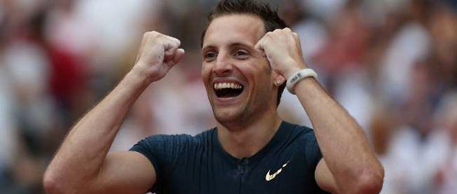 Renaud Lavillenie, heureux après avoir battu le record de France (6,02 m) samedi dernier à Londres.