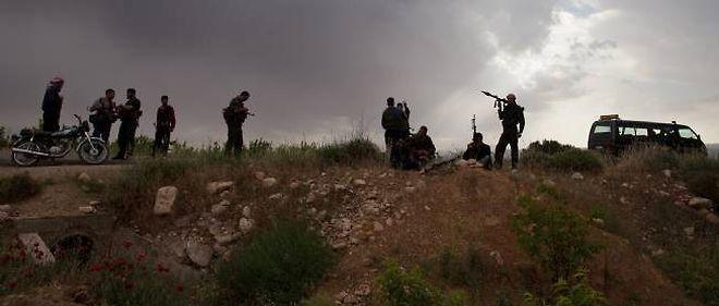 Des rebelles syriens près de Homs. © - / AFP