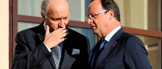 François Hollande et Laurent Fabius à Saint-Pétersbourg.