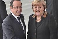 François Hollande et Angela Merkel. ©BERTRAND LANGLOIS / AFP