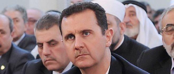 """Le président syrien Bachar al-Assad a annoncé lors d'un entretien diffusé vendredi qu'il se présenterait à la présidentielle de 2014 si son peuple le """"voulait""""."""