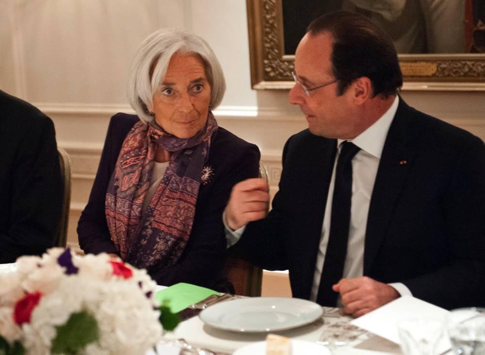François Hollande et Christine Lagarde, lundi soir. ©  NICHOLAS KAMM / POOL / AFP