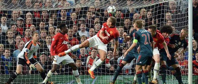 Le défenseur de Manchester United Nemanja Vidic a ouvert le score contre le Bayern Munich, mardi soir en quart de finale aller de la Ligue des champions.