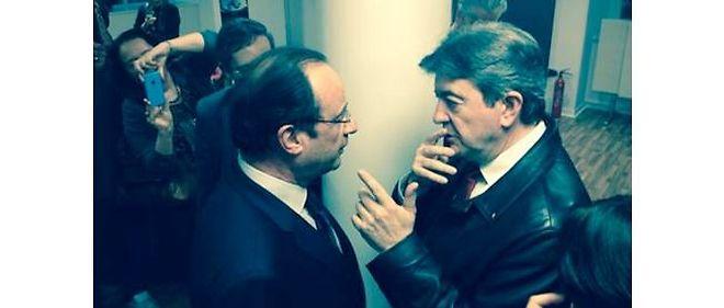 François Hollande et Jean-Luc Mélenchon au pot de départ de Sylvie Maligorne, chef du service politique de l'Agence France-Presse.