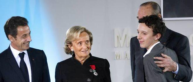 Nicolas Sarkozy, Bernadette et Jacques Chirac, accompagnés de leur petit-fils Martin Rey-Chirac en 2009.