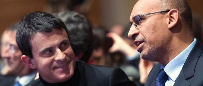 Harlem Désir et Manuel Valls. © BERTRAND LANGLOIS / AFP