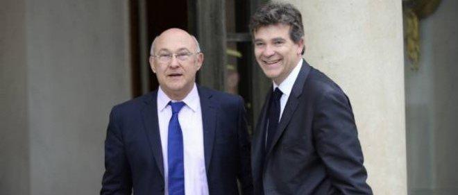 Les ministres des Finances, Michel Sapin, et de l'Économie, Arnaud Montebourg. Photo d'illustration.