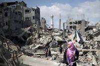Les habitants de Gaza reviennent dans leurs maisons détruites, samedi matin, durant le cessez-le-feu de 12 heures. ©MAHMUD HAMS / AFP PHOTO