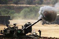 À la frontière entre Israël et Gaza, un tir d'artillerie israélien le 30 juillet. ©JACK GUEZ / AFP PHOTO