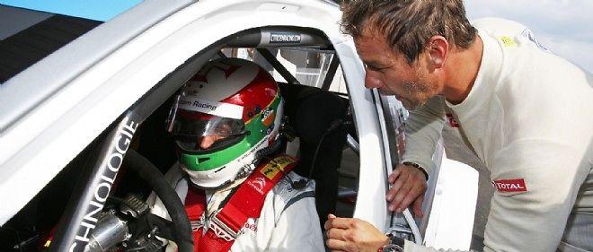 Carlos Tavares, conseillé ici par Sébastien Loeb avant son essai de la Citroën C-Élysée championne du monde des voitures de tourisme, oriente la stratégie de développement de PSA vers la Chine, notamment en engageant le pilote chinois Ma Qing Hua pour porter les couleurs du groupe en WTCC.