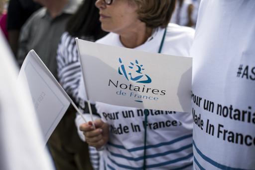 Des notaires dans la rue à Paris le 17 septembre 2014 protestent contre le projet de réforme des professions réglementées © Fred Dufour AFP/Archives