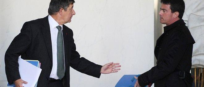 Jean-Pierre Jouyet et Manuel Valls, le 12 novembre 2014, à Paris.