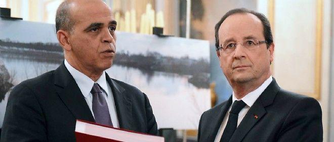 François Hollande et Kader Arif en novembre 2013. Un an plus tard, le secrétaire d'État a remis sa démission au président de la République.