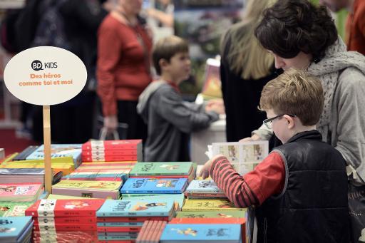 Des visiteurs au 30e Salon du Livre et de la Presse Jeunesse de Montreuil, près de Paris, le 26 novembre 2014 © Stéphane de Sakutin AFP