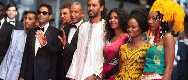 Autour d'Abderahmane Sissako, les acteurs principaux de Timbuktu le 15 mai dernier au Festival de Cannes.
