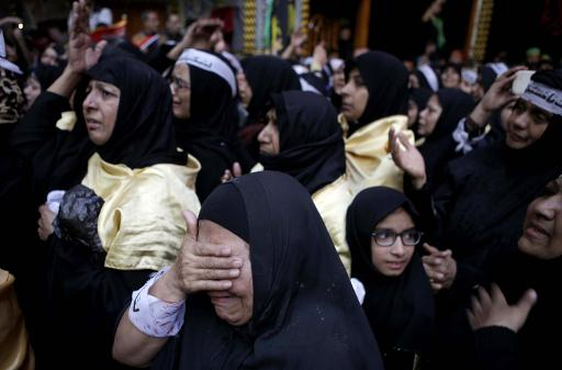 Des pèlerins chiites, le 13 décembre 2014 à Kerbala, en Irak © Mohammed Sawaf AFP