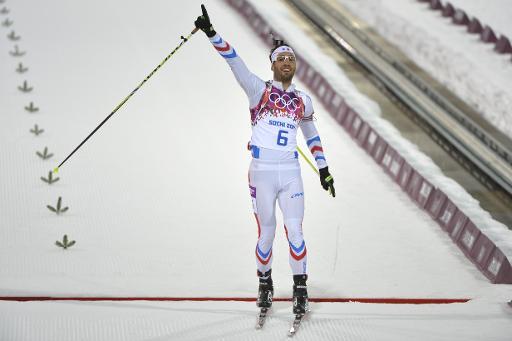 Le biathlète français Martin Fourcade, sacré champion olympique de poursuite, aux JO de Sotchi, le 10 février 2014 à Rosa Khutor © Odd Andersen AFP/Archives