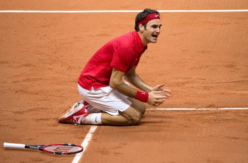 L'émotion du Suisse Roger Federer après la victoire en finale de Coupe Davis face à la France le 23 novembre 2014 à Villeneuve-d'Ascq © Denis Charlet AFP