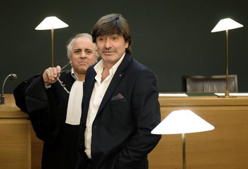 L'ancien chef de la pj lyonnaise Michel Neyret (D) et son avocat Yves Sauvayre le 16 décembre 2014 à Lyon © Philippe Desmazes AFP/Archives