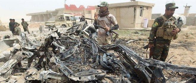 Miliciens chiites dans la banlieue de Tikrit, le 12 mars.