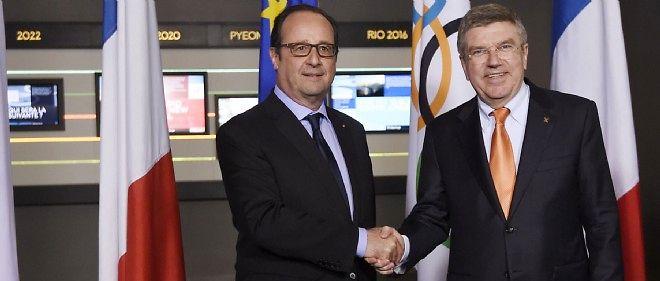 François Hollande et le président du Comité international olympique (CIO), Thomas Bach, le 16 avril à Lausanne.
