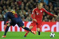 Gérard Piqué et Arjen Robben vont à nouveau devoir croiser le fer en demi-finale. ©Lluis GENE