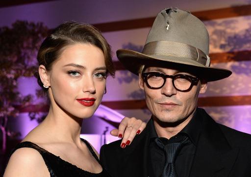 """Amber Heard et Johnny Depp lors de la 7e édition de """"The Art of Elysium"""", le 11 janvier 2014 à Los Angeles © Michael Kovac GETTY IMAGES NORTH AMERICA/AFP/Archives"""