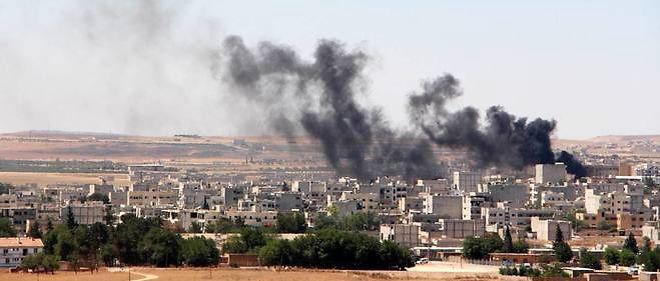De la fumée s'échappe de la ville de Kobane, Photo d'illustration.