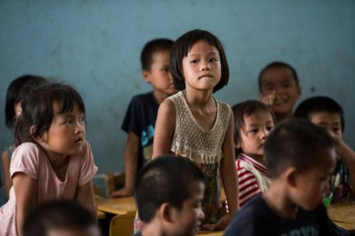 Des élèves d'une école primaire de Longfu Township, dans la région autonome de Guangxi en Chine, le 19 juin 2015 © JOHANNES EISELE AFP