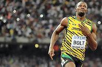 Le Jamaïcain a conservé son titre de champion du monde du 100 m en dominant l'Américain Justin Gatlin dimanche 23 août à Pékin. ©OLIVIER MORIN