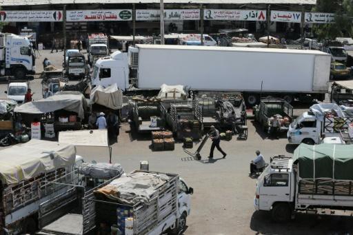 La ruée des camions au marché des Halles de Damas, le 21 septembre 2015 © JOSEPH EID AFP