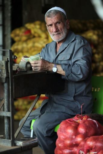 Un négociant syrien au marché des Halles de Damas, le 21 septembre 2015 © JOSEPH EID AFP