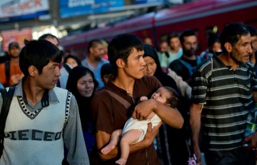 Des migrant afghans à leur arrivée le 31 août 2015 à la gare de Munich © Sven Hoppe DPA/AFP/Archives