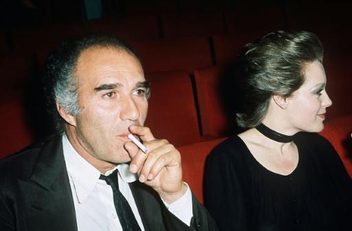 """L'actrice Romy Schneider et l'acteur français Michel Piccoli assistent en février 1971 à Paris à la projection de leur film """"Max et les ferrailleurs"""". ©  AFP/Archives"""